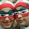 Photo - Iranian fans wait for the start of the group F World Cup soccer match between Bosnia and Iran at the Arena Fonte Nova in Salvador, Brazil, Wednesday, June 25, 2014. (AP Photo/Sergei Grits)