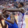 Photo - Los Angeles Clippers center DeAndre Jordan, right, smacks Oklahoma City Thunder forward Kevin Durant on the head as he goes up for a shot in the first half of Game 4 of the Western Conference semifinal NBA basketball playoff series, Sunday, May 11, 2014, in Los Angeles. (AP Photo/Mark J. Terrill)