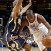 Oklahoma City\'s Kevin Durant (35) drives around Indiana\'s Dahntay Jones (1) during the NBA basketball game between the Oklahoma City Thunder and the Indiana Pacers at the Oklahoma City Arena, Wednesday, March 2, 2011. Photo by Bryan Terry, The Oklahoman