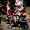 Mackenzie McKay, 5, left, Mason Moreno, 2, and Madison Moreno, 3, get a ride outside the stadium before a college football game between the University of Oklahoma Sooners (OU) and the West Virginia University Mountaineers at Gaylord Family-Oklahoma Memorial Stadium in Norman, Okla., on Saturday, Sept. 7, 2013. Photo by Bryan Terry, The Oklahoman