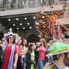 Wearing a ferris wheel hat, Mike Revenaugh, of the Queens borough of New York, right, poses for photographers as he and others take part in the Easter Parade along New York\'s Fifth Avenue Sunday April 24, 2011. (AP Photo/Tina Fineberg)
