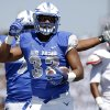 Photo - Air Force running back Broam Hart, front, celebrates his touchdown run as Nicholls State linebacker Ronnie Walker, back, looks on in the second quarter of an NCAA college football game at Air Force Academy, Colo., on Saturday, Aug. 30, 2014. (AP Photo/David Zalubowski)