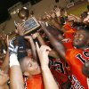 The Douglass Trojans raise the championship trophy after beating the Star Spencer Bobcats in the championship game of the All-City Athletic Conference Football Preview at Taft Stadium in Oklahoma City, Friday, August 24, 2007. By Nate Billings, The Oklahoman