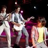 The Jonas Brothers, Nick, at left, Kevin, and Joe, perform at the Ford Center in Oklahoma City, Tuesday, July 8, 2008. BY BRYAN TERRY, THE OKLAHOMAN