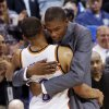 INJURED / HUG: Oklahoma City\'s Kevin Durant hugs Russell Westbrook (0) after Westbrook finished with a triple-double in the NBA basketball game between the Dallas Mavericks and the Oklahoma City Thunder at the Ford Center in Oklahoma City, March 2, 2009. The Thunder won 96-87. Durant did not play due to injury. BY NATE BILLINGS, THE OKLAHOMAN ORG XMIT: KOD