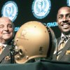 Barry Alvarez, left, former Wisconsin coach, and Desmond Howard, former Michigan receiver, smile during a news conference Thursday announcing the 2010 College Football Hall of Fame Class. AP photo