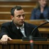 Photo - FILE - In this Tuesday, July 8, 2014 file photo Oscar Pistorius sits in the dock in Pretoria, South Africa, at his murder trial for the shooting death of his girlfriend Reeva Steenkamp on St. Valentine's Day, 2013. In newspaper reports Pistorius has been accused of an aggressive altercation at a Johannesburg nightclub he visited at the weekend.  A spokeswoman for the Pistorius family said an argument ensued and the athlete, who is free on bail, soon left the club. He had been seated in a quiet booth in the VIP section, she said in a statement. (AP Photo/Alon Skuy, Pool, File)