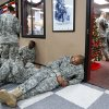 A US Army spokesman from Ft. Sill said nearly 1,000 troops boarded buses for the trip to Will Rogers World Airport in Oklahoma City to catch flights home for the Christmas holidays. Buses filled with soldiers began arriving at the airport after midnight Wednesday and into the pre-dawn hours on Thursday, Dec. 19, 2013. While waiting to board flights, the troops were treated to food and warm beverages at the YMCA Military Welcome Center at the airport. Soldiers were offered pizza, doughnuts and sub sandwiches, with hot coffee or chocolate, and bottled water. Friendly faces from local organizations were there to greet them and assist them. Volunteers represented several groups, including Blue Star Mothers, Patriot Guard Riders and an organization consisting of Purple Heart recipients. Photo by Jim Beckel, The Oklahoman