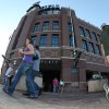 In this photo taken with a fisheye lens, fans exit Coors Field after the cancellation of a baseball game between the Cincinnati Reds and the Colorado Rockies because of a water main break in front of the stadium in downtown Denver on Saturday, Aug. 16, 2014. The game will be made up on Sunday as part of a split doubleheader. (AP Photo/David Zalubowski)