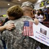 Cpt. Clint Yates gets a hug from his son during a ceremony for the Oklahoma National Guardsmen from the 45th Infantry Division\'s return from Operation Iraqi Freedom at Southern Nazarene University on Tuesday, Oct. 14, 2008, in Oklahoma City, Okla. CHRIS LANDSBERGER, THE OKLAHOMAN
