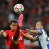 Photo - Leverkusen's  Sebastian Boenisch, left, challenges for the ball with Berlin's  Roy Beerens, during the German Bundesliga soccer match between Bayer Leverkusen and Hertha BSC Berlin in Leverkusen, western Germany, Saturday Aug. 30, 2014.   (AP Photo/dpa,Jonas Guettler)