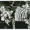Carl Albert coach Dub Raper makes a plea to the officials, who are holding a mid-court conference in Friday\'s 4A semifinal game. STAFF PHOTO BY JIM BECKEL THE OKLAHOMAN (Photo taken March 10, 1989) (Photo published March 11, 1989 in The Daily Oklahoman)