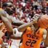 Iowa State forward Anthony Booker tries to knock the ball away from Oklahoma State guard Markel Brown (22) during the first half of an NCAA college basketball game, Wednesday, March 6, 2013, in Ames, Iowa. (AP Photo/Justin Hayworth) ORG XMIT: IAJH103