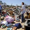 Relatives of John and Barbara DeCouser salvage items from their home in Steelman Estates in Bethel Acres on Wednesday, May 22, 2013. Their home was destroyed in Sunday evening\'s deadly tornado that swept through their small neighborhood leaving massive destruction.The DeCousers were in their home when the tornado ripped it apart. Both were taken to a hospital. John received head injuries and a fractured neck. He has been released. Barbara remains hospitalized with a back injury. Relatives said parts of two other homes landed on top of the DeCouser\'s home. Photo by Jim Beckel, The Oklahoman.