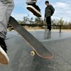 Ryan Bell, of Midwest City, watches Matt Collins, of Choctaw, attempt a trick on the hip as they skate at Lions Skate Park in Midwest City on Wednesday, March 11, 2008. By John Clanton, The Oklahoman