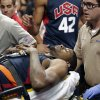 Photo - Indiana Pacers' Paul George is taken off the court after he was injured during the USA Basketball Showcase game Friday, Aug. 1, 2014, in Las Vegas. (AP Photo/John Locher)