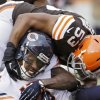 Photo - Chicago Bears wide receiver Brandon Marshall (15) is tackled by Cleveland Browns inside linebacker Craig Robertson (53) after a catch in the first quarter of an NFL football game, Sunday, Dec. 15, 2013, in Cleveland. (AP Photo/Tony Dejak)