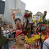 Supporters of Venezuela\'s President Hugo Chavez cheer during the ceremony declaring Chavez official winner of Sunday\'s presidential elections outside the Electoral Council in Caracas, Venezuela, Wednesday, Oct. 10, 2012. During the event Chavez announced a new vice president, choosing his longtime foreign minister Nicolas Maduro. (AP Photo/Fernando Llano)
