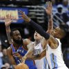 Oklahoma City Thunder guard James Harden (13) is pressured by Denver Nuggets center Chris Andersen (11) and J.R. Smith, right, during the second half of game 3 of a first-round NBA basketball playoff series Saturday, April 23, 2011, in Denver. (AP Photo/Jack Dempsey)