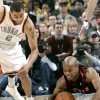 Oklahoma City\'s Thabo Sefolosha and Toronto\'s Jarrett Jack chase down a loose ball during their NBA basketball game at the Ford Center in Oklahoma City on Sunday, Feb. 28, 2010. Photo by John Clanton, The Oklahoman