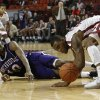 Northwestern\'s Patrick Robinson (10) and Oklahoma\'s Amath M\'Baye (22) fight for a ball during a men\'s college basketball game between the University of Oklahoma and Northwestern Louisiana State University at the Lloyd Noble Center in Norman, Okla., Friday, Nov. 30, 2012. Photo by Garett Fisbeck, The Oklahoman