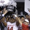 Oklahoma\'s Jeremy Beal and coach Bob Stoops hold up the Big 12 Championship trophy after the 23-20 win over Nebraska during the Big 12 football championship game between the University of Oklahoma Sooners (OU) and the University of Nebraska Cornhuskers (NU) at Cowboys Stadium on Saturday, Dec. 4, 2010, in Arlington, Texas. Photo by Chris Landsberger, The Oklahoman