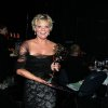 "Photo -   Martha Plimpton poses backstage with her award for outstanding guest actress in a drama series for playing Patti Nyholm on ""The Good Wife"" at the 2012 Creative Arts Emmys at the Nokia Theatre on Saturday, Sept. 15, 2012, in Los Angeles. (Photo by Matt Sayles/Invision/AP)"