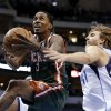 Milwaukee Bucks\' Brandon Jennings (3) gets past Dallas Mavericks\' Dirk Nowitzki (41) during the first half of an NBA basketball game Tuesday, Feb. 26, 2013, in Dallas. (AP Photo/Tony Gutierrez)