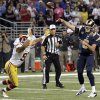 Photo -   St. Louis Rams quarterback Sam Bradford, right, throws a touchdown pass to teammate Matthew Mulligan as Washington Redskins linebacker Lorenzo Alexander, left, defends during the fourth quarter of an NFL football game on Sunday, Sept. 16, 2012, in St. Louis. (AP Photo/Tom Gannam)