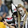 Photo - Juventus supporters celebrate their team's victory of the overall soccer title prior to the start of a Serie A soccer match between Juventus and Atalanta, at the Juventus stadium, in Turin, Italy, Monday, May 6, 2014. Juventus won its 30th  title three rounds ahead of the end of the championship. (AP Photo/Massimo Pinca)