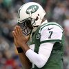 Photo - New York Jets quarterback Geno Smith gestures after scoring on a touchdown run against the Oakland Raiders during the second half of an NFL football game on Sunday, Dec. 8, 2013, in East Rutherford, N.J. (AP Photo/Peter Morgan)