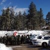 Law enforcement officials gather to discuss plans to resume the search for fugitive Christopher Dorner, Saturday Feb. 9, 2013 near Big Bear, Calif. More than 100 law enforcement officers, some in armored personnel carriers, hunted Saturday for the former Los Angeles police officer suspected of going on a deadly rampage this week to get back at those he blamed for ending his police career. (AP Photo/Tami Abdollah)