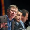 Photo - Colo. Governor John Hickenlooper, left, gestures during a roundtable discussion titled The Impacts of Major Western Oil and Gas Finds: Meeting Challenges and Capturing Opportunities, during the annual Western Governors' Association Meeting, at the Broadmoor Hotel in Colorado Springs, Tuesday, June 10, 2014.   The head of the Environmental Protection Agency promoted proposed clean power plant rules to Western governors Tuesday, framing the plan as a way to deal with destructive wildfires and floods that have ravaged the region in recent years. (AP Photo/Brennan Linsley)