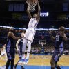 Oklahoma City \'s Kevin Durant (35) dunks the ball during the NBA basketball game between the Oklahoma City Thunder and the Charlotte Bobcats at the Chesapeake Energy Arena, Sunday, March 2, 2014. Photo by Sarah Phipps, The Oklahoman