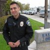 Photo - Rookie police officer Alex Salinas, 22, poses at the police station in Exeter, Calif. On his second trip through high school, former C-student Alex Salinas got a lot of A's. He was 22, however, and an undercover narcotics officer going by the name Johnny Ramirez. (AP Photo/Tracie Cone)