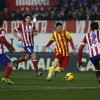 Photo - Barcelona's Lionel Messi from Argentina, center,  controls the ball  in between players  during a Spanish La Liga soccer match between Atletico de Madrid and FC Barcelona at the Vicente Calderon stadium in Madrid, Spain, Saturday, Jan. 11, 2014. (AP Photo/Gabriel Pecot)