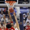 Whitney Hand blocks a shot by Deseree\' Byrd in the second half as the University of Oklahoma plays Louisville at the 2009 NCAA women\'s basketball tournament Final Four in the Scottrade Center in Saint Louis, Missouri on Sunday, April 5, 2009. Photo by Steve Sisney, The Oklahoman