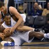 Photo -   Orlando Magic forward Glen Davis (11) is fouled by Brooklyn Nets center Brook Lopez after gaining control of a loose ball during the first half of an NBA basketball game in Orlando, Fla., Friday, Nov. 9, 2012.(AP Photo/Phelan M. Ebenhack)