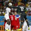Ghana\'s goalkeeper Adam Kwarasey (12) leaps up to bat the ball away from United States\' Aron Johannsson (9) and Geoff Cameron (20) during the group G World Cup soccer match between Ghana and the United States at the Arena das Dunas in Natal, Brazil, Monday, June 16, 2014. (AP Photo/Julio Cortez)