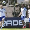 Photo - Argentina's Lionel Messi, left, controls the ball  next to teammates Gonzalo Higuain, center, and Ezequiel Lavezzi, right, during a training session in Vespesiano, near Belo Horizonte, Brazil, Saturday, June 28, 2014.  Argentina plays in group F of the 2014 soccer World Cup. (AP Photo/Victor R. Caivano)