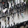 Opponents of Egyptian President Mohammed Morsi clash with Islamist supporters of the president, unseen, as a cordon of riot police separates the groups in Alexandria, Egypt, Friday, Dec. 21, 2012. Thousands of Islamists clashed with their opponents Friday in Egypt\'s second largest city, Alexandria, on the eve of the second leg of voting on the country\'s contentious constitution that has deeply polarized the nation.(AP Photo/Ahmed Ramadan)