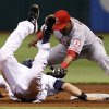 Photo -   Los Angeles Angels shortstop Erick Aybar, right, tags out Tampa Bay Rays' Ben Zobrist at second base after Zobrist was picked off by Angels pitcher Jerome Williams during the first inning of a baseball game, Thursday, April 26, 2012, in St. Petersburg, Fla. (AP Photo/Chris O'Meara)