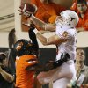 UT\'s Jaxon Shipley (8) makes a touchdown catch over OSU\'s Kevin Peterson (1) in the third quarter during a college football game between Oklahoma State University (OSU) and the University of Texas (UT) at Boone Pickens Stadium in Stillwater, Okla., Saturday, Sept. 29, 2012. Texas won, 41-36. Photo by Nate Billings, The Oklahoman