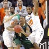 Oklahoma State \'s Phil Forte (10) and Michael Cobbins (20) defend on South Florida Bulls\' Anthony Collins (11) during the college basketball game between Oklahoma State University (OSU) and the University of South Florida (USF) on Wednesday , Dec. 5, 2012, in Stillwater, Okla. Photo by Chris Landsberger, The Oklahoman