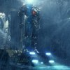 """Photo -  This film publicity image released by Warner Bros. Pictures shows the Gipsy Danger robot in a scene from """"Pacific Rim."""" """"Pacific Rim"""" fulfills a very basic boyhood fantasy: big ol' robots and giant monsters slugging it out. The concept to Guillermo del Toro's """"Godzilla""""-sized film is about as simple as it gets, but actually constructing such mammoth creations is a far more arduous undertaking. (AP Photo/Warner Bros. Pictures) ORG XMIT: NYET527"""