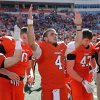 Oklahoma State\'s J.W. Walsh (4) sings the school song after the Cowboy\'s 24-10 win over TCU during a college football game between the Oklahoma State University Cowboys (OSU) and the Texas Christian University Horned Frogs (TCU) at Boone Pickens Stadium in Stillwater, Okla., Saturday, Oct. 19, 2013. Photo by Chris Landsberger, The Oklahoman