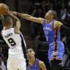 Oklahoma City\'s Russell Westbrook (0) defends San Antonio\'s Tony Parker (9) during Game 1 of the Western Conference Finals between the Oklahoma City Thunder and the San Antonio Spurs in the NBA playoffs at the AT&T Center in San Antonio, Texas, Sunday, May 27, 2012. Oklahoma City lost 101-98. Photo by Bryan Terry, The Oklahoman