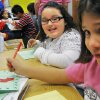 From left, Cole Weldon, Lexy Martinez and Olivia Leal make Christmas cards for troops during a visit by former State Rep. Kevin Calvey to students at Angie Debo Elementary School in Edmond Friday, Nov. 14, 2008.. Photo by Jesse Olivarez