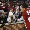 OU / COLLEGE FOOTBALL / CELEBRATE / CELEBRATION: University of Oklahoma quarterback Sam Bradford celebrates with fans following Oklahoma\'s 65-21 victory over Texas Tech in an NCAA college football game in Norman, Okla., Saturday, Nov. 22, 2008. (AP Photo/Sue Ogrocki) ORG XMIT: OKSO123