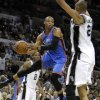 Oklahoma City\'s Russell Westbrook (0) tries to pass the ball around San Antonio\'s Tim Duncan (21) during Game 2 of the Western Conference Finals between the Oklahoma City Thunder and the San Antonio Spurs in the NBA playoffs at the AT&T Center in San Antonio, Texas, Tuesday, May 29, 2012. Photo by Bryan Terry, The Oklahoman